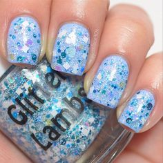 Jack Frost is a Christmas Glitter Topper Indie Nail Polish that is a clear base filled with light baby blue hearts, white squares, blue dots,