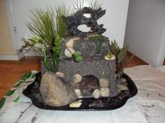 (link) DIY homemade Hide ~ Materials to use: ~ aquarium safe silicone, 2 plastic containers, one of which is much bigger in all dimensions than the other. ~ Lots of river stones. ~ Fake aquarium plants ~ Sand, same color as you have in the tank. Diy Aquarium, Aquarium Design, Aquarium Decorations, Planted Aquarium, Aquarium Ideas, Hermit Crab Habitat, Hermit Crabs, Reptiles, Amphibians
