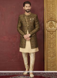 Gripping black and gold indo western with fancy floral patterns on the collar sleeve cuffs and lower part of the indo western. Comes with matching style bottom. Blazer For Men Wedding, Sherwani For Men Wedding, Wedding Dresses Men Indian, Groom Wedding Dress, Mens Sherwani, Sherwani Groom, Wedding Men, Men's Wedding Wear, Wedding Outfits For Men