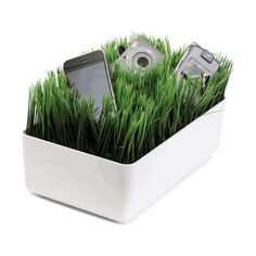 """Grass Charging Station with White Base  $26.99    Sorry, we are temporarily out of this item. Please enter your e-mail address below and we will let you know when it is back in stock.      (review this item)    (see all 2 reviews)  Features:   • Faux grass hides messy cords   • White plastic base   • For use with most electronics    Size: 4 1/3""""tall x 11""""wide x 7""""deep"""