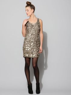 I think this open weave with patterned sequin dress is so pretty. But I know I would destroy it in no time. I always manage to get on something and snag my delicate things. But it sure would be great for holiday parties.