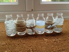 Washi tape, lace and twine glass bottles for the centre pieces at the wedding, easy DIY!