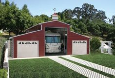 steel building red | RV Barn in farm red steel, building with 3 bays and landscaped setting ...