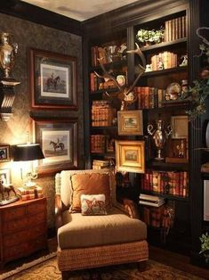"""There should never be a fear of """"too dark"""" rooms. Could this be any cozier?  A perfect example of layering accessories, using rich colors, dramatic lighting to create inviting ambience."""