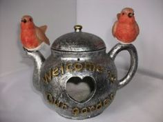 tea-kettle-bird-house-robin-garden-ornament-232-p[ekm]288x216[ekm].jpg 288×216 pixels