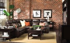 [Living Room] : Modern Living Room Decor Ideas With Prepossessing Expensive Leather Sofas Home Design Ideas With Wooden Polished With Synthetic Rug Also Table And Streamlined And Cabinets Also Brick Walls Decor Interior Along With Black Sofa Sets