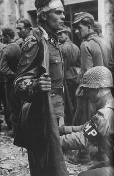 SS Officer Being Searched by an American Miltary Policeman, Normandy, 1944 (Robert Capa)