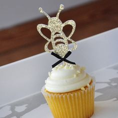 "Bumble Bee Cupcake Topper. Mommy to Bee. What Will it Bee. Sweet As Can Bee. 12CT. Our Confetti Momma ""Bumble Bee Cupcake Toppers"" are perfect for bringing a little fun and whimsy to your bee themed baby shower, bridal shower or birthday party. They will make your home made or store bought cupcakes look like a million bucks. And don't be afraid to stick them in other random foods. I'm thinking muffins, brownies and if you're feeling crazy stick them in a steak. Why not?."