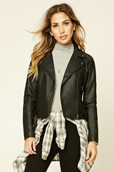 A faux leather moto jacket featuring an asymmetrical zippered front, two zippered pockets, collar, belted waist, and long sleeves with…