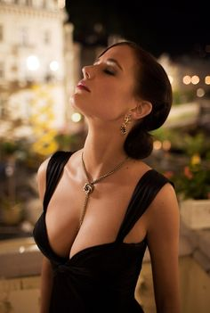 I adore this dress! The shape of the neckline is amazing and actually quite tasteful for such a low cut. Eva Green / Casino Royale