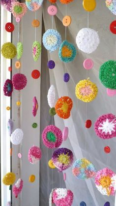 I had leftover crochet earring's that I almost got rid of until I saw this and realized....this would make an awesome baby mobile!