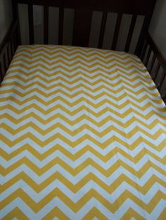 Yellow chevron bedding with grey walls?