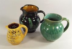 WILLIAM FISHLEY-HOLLAND. Two William Fishley-Holland jugs & a Brannam Pottery puzzle jug.