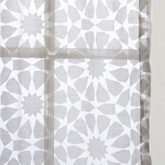 Inspired by Moroccan floor tiles, the burnout technique used on the Rosette Tile Curtain creates a beautiful design that's both sheer and opaque.