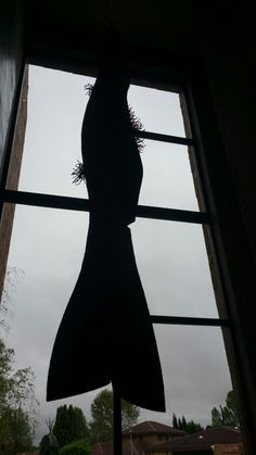 My sculpture entitled :A tall story..hanging ominously in its volume and turns slowly as the air moves around it....
