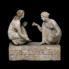 Terracotta group of 'knucklebone' (astragalos) players  Hellenistic Greek, about 330-300 BC Said to be from Capua; Made in either Campania or Puglia, southern Italy