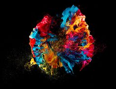 popping a balloon covered in paint high-speed photoraphy by fabian oefner. Cooool.
