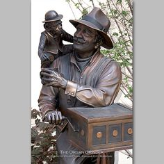 """This is a Photo of a Sculpture located in the Country Club Plaza in Kansas City, Missouri titled """"Organ Grinder"""". Photography by Dennis Dierks."""