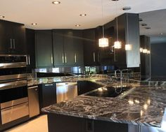 Interior Design, Charming Modern Kitchen Table With Black And White Granite Countertops Also Black Kitchen Cabinet Also Modern Small Pendant Lights With Cube Shaped: Support Your Kitchen Room with Black and White Granite White Granite Countertops, Kitchen Design, Kitchen Backsplash, Modern Kitchen, Kitchen Countertops, Kitchen Room, Modern Kitchen Tables, Countertops, Kitchen Technology