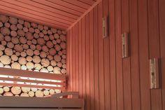Zu den Highlights gehören die mit Baumscheiben verzierten Wände, welche ein naturnahes Ambiente erschaffen.
