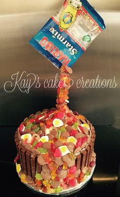 Strawberry sponge vanilla buttercream gravity cake with chocolate buttons and haribos. My first gravity cake can't wait to do the next one now.