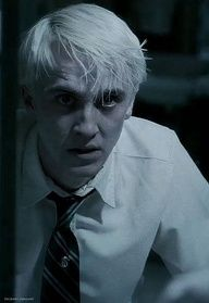 Draco Malfoy as played by  Tom Felton in The Harry Potter series.  Draco is a major antagonist in the Harry Potter series. A spoiled, self-centered bully and the son of Lucius Malfoy, a Death Eater serving under Lord Voldemort.
