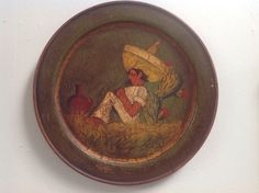"""Another rare Monterey wood roundel with green crackle-painted finish featuring a signature character by Juan Tinoco, a Mexican folk artist who worked for Mason Manufacturing in Los Angeles, c.1930's. The 13"""" diameter plaque is branded """"Rancho-O"""" on reverse. This example is  available as of August 2015 in the Los Angeles area - contact tilehog@earthlink.net for more information."""