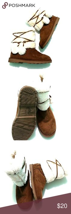 Like New Furry Brown Boots 7 Cute furry moccasin style boot. With little furry tassels or balls. Cream and brown. makalu California Shoes Ankle Boots & Booties