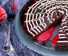 How about this disgustingly delicious Chocolate Oreo Tart disguised as a gruesome & bloody spider web treat eh?! This no bake delight is terrifyingly tasty, easy to make & will blow your Halloween party guests' minds when they cut into it and reveal a bloody surprise. Have I got your attention? Good!Here is what you will need to serve 8 – 10. The Base 245g Oreos80g Unsalted Butter The Filling Half a 395g Tin of CaramelRed Food Colouring Gel175g Dark Chocolate, Finely Chop...