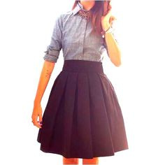 Full skirt paired with tailored shirt. Great proportions.