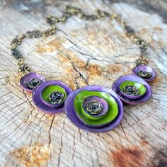 purple green polymer clay necklace floral necklace flower necklace floral jewelry nature necklace purple green  flowers statement necklace by Fantazzihandmade on Etsy https://www.etsy.com/listing/235905852/purple-green-polymer-clay-necklace