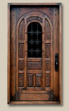 Front Entry Constructed from antique carved panels, reclaimed Douglas fir and custom grillwork. Features bronze thumb latch entry set with teardrop key flap, clavos & custom template glass. 7704A Rogers
