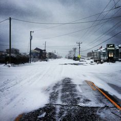 A desolate and snowy beach road in Kill Devil Hills. :: January 29, 2014 :: #snOBX