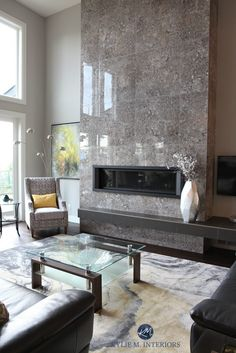A Contemporary and Comfortable New Home in Nanaimo Tile 2 storey fireplace. Gray and yellow colour palette. Kylie M Interiors E-decor and Online Color Consulting Linear Fireplace, Tall Fireplace, Home Fireplace, Fireplace Remodel, Living Room With Fireplace, Fireplace Surrounds, Fireplace Modern, Fireplace Hearth, Fireplace Ideas