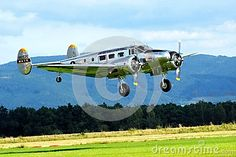 American propeller driven plane from Czech Republic with wheels down coming in to land on a grassy airfield.