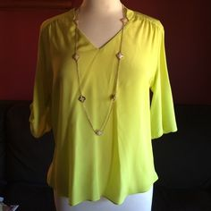 """Amanda Uprichard Lime Green 100% Silk Blouse Add a pop of color to any outfit with this pretty silk blouse. A fun lime green color with 3/4 length sleeves that can be buttoned up as well. Measures 24"""" inches in the front, 28"""" inches in the back and 20"""" inches armpit to armpit. Amanda Uprichard Tops Blouses"""