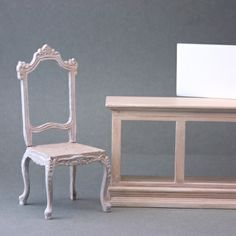 These two unified pieces of dolls house furniture began as totally unrelated pieces, one stark white, the other gilded dark wood.