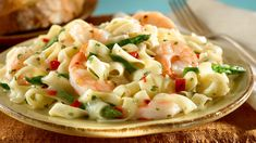 SEAFOOD PASTA - If you are looking for a new pasta dish to add to your repertoire, this one is for you. Our creamy seafood pasta recipe is packed with succulent prawns and vegetables. Creamy Seafood Pasta, Shrimp Scampi Pasta, Seafood Pasta Recipes, Romantic Meals, Romantic Recipes, Angel Hair Pasta Recipes, Vegetable Pasta, Croatian Recipes, Garlic Shrimp