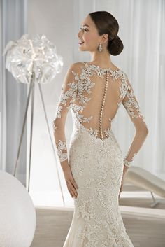 Shimmering beaded lace dress with dramatic illusion back and button closures. #DemetriosBride Style 639.