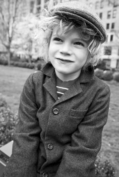 love the little newsboy cap and crazy hair.