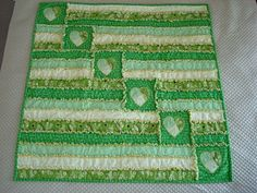 I'm really liking this one....  rag quilt via http://closetcrafterohio.blogspot.com/2011/01/rag-heart-baby-quilt.html