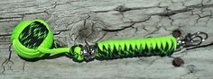 "Monkey Fist Paracord with Skull Bead Black and Green 7 1 2"" Long 