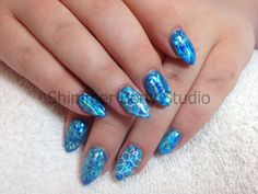 Gel nails, pointed almond nails, blue glitter foil nails, konad stamping nail art by Shimmer Body Studio.