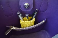 Don't be afraid to put pens in your expensive handbag anymore. Makes a lovely gift too.