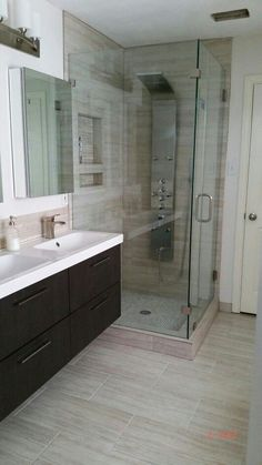 My modern bathroom remodel: I wanted a stone look but needed the low maintenance of porcelain, and I found the perfect solution! Product list: Akdy shower panel, Pfister Venturi faucet, Ikea Godmorgon cabinets.