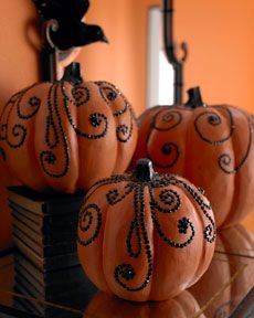 Paper Mache pumkins painted orange then some decorative upholstry tacks (if there are some small enough) or whatever is I can come up with.