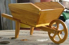 wood wheelbarrow planters