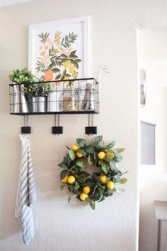 This lovely kitchen wall display with lemon wreath and art is perfect for spring decor! Lemon Kitchen Decor, Spring Kitchen Decor, Lemon Wreath, Home Interior, Stores, Farmhouse Decor, Farmhouse Style, Farmhouse Ideas, Sweet Home