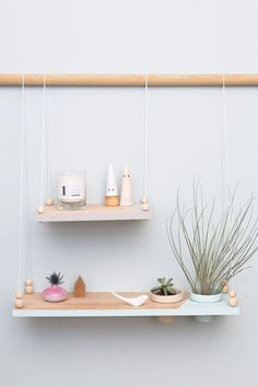 Shop display shelf with wooden beads and geometric touches.
