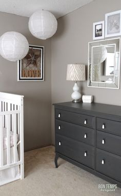 White crib, taupe walls (perfect taupe' by Behr) and dark grey dresser. I'd add navy blue pom poms mixed in with white and red
